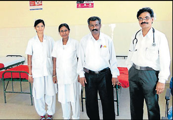Paediatrician Dr Raveendra, administrative officer Dr M Raghu and staff at the nutritious food and rehabilitation centre opened to curb death due to malnutrition at a hospital in Kollegal. dh photo