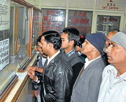 Commute easy : People line up for bus passes at a DTC office.