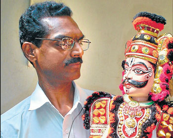 K V Ramesh with a puppet.