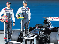 Waiting to make a name : Williams drivers Bruno Senna (right) and Pastor Maldonado pose next to the FW34 car that was unveiled in Jerez on Tuesday. reuters