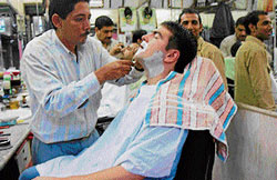 Getting decked : Parlours for men dot every corner of the City.