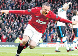 red hot: Man United's Wayne Rooney celebrates after scoring against Liverpool. AFP