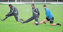 (From left) Bayer Leverkusen's Simon Rolfes, Karim Bellarabi and Stefan Kiessling stretch during a training session ahead of their Champions League last-16 clash against defending champions Barcelona on Tuesday. AP