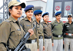 On guard : Womnen CISF personnel at Delhi Metro.