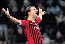 AC Milan's Zlatan Ibrahimovic is in a mood to rejoice after firing home a penalty against Arsenal in the Champions League on Wednesday. Reuters
