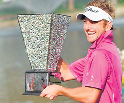 ONE FOR THE ALBUM: South Africa's Jbe Kruger poses with the Avantha Masters trophy. AFP