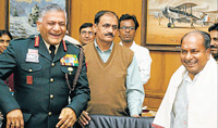 Who will have the last laugh? Defence Minister A K Antony (right) and Army Chief General V K Singh at a function in New Delhi on Tuesday.