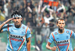 SALUTE THE SPIRIT: Shivendra Singh (left) celebrates India's first goal against Canada as SVSunil joins him in NewDelhi onWednesday. PTI