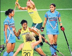 TEAM WORK South Africa's Sulette Damons celebrates with team-mate Nicolene Terblanche (20) after scoring against India in the Olympic Qualifiers onWednesday.