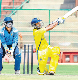 heave ho: Tami Nadu's Dinesh Kaarthick smashes a six during his quickfire century against Karnataka in the Subbaiah Pillai Trophy on Thursday. DH PHOTO/ Srikanta Sharma R