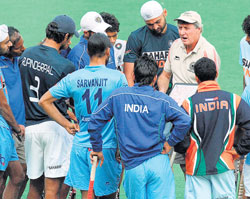FINISHING TOUCHES: Indian coach Michael Nobbs discusses a point with the players during a training session in New Delhi on Thursday. AFP