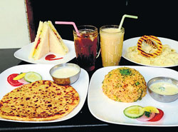 Popular pick : Parathas, sandwiches, pasta, a rice item and juices. dh photo by dinesh s k
