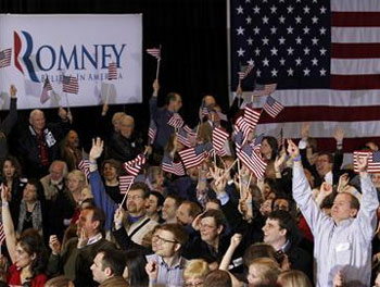 Supporters of Mitt Romney cheer as television networks project that Romney has won the Arizona primary, at his Michigan primary night rally in Novi, Michigan, February 28, 2012. Reuters