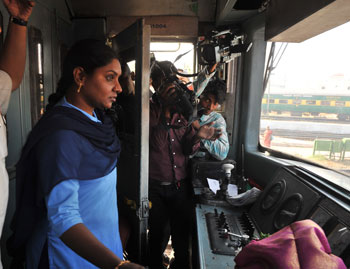 Satyavathi, the first independent Indian woman locomotive pilot of South Central Railway drives a Mathrubhoomi Ladies Special train in Hyderabad on March 8, 2012, on International Women's Day. AFP