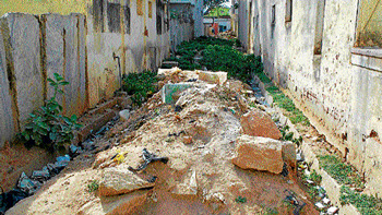 The road behind Krishna theatre in ward no 10 in Chikkaballapur remains closed, as it is  converted into a dumpyard. DH Photo