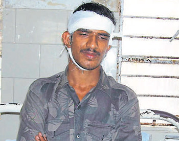 Injured ANF constable Sadashiva Choudhary at a hospital in Belthandy.