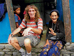 An undated photograph shows Italian national Paolo Bosusco (C) posing with a tribal woman. AFP