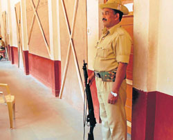 Police guarding the strong rooms where the EVMs have been kept, at T A Pai English Medium School in Kunjeebettu in Udupi.