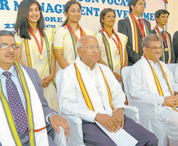memorable: Gold medallists pose for a photo along with the dignitaries- S R Parasuraman, S Ramadorai, D Veerendra Heggade, S Prabhakar and K Sudha Rao at the convocation ceremony at SDM- IMD in Mysore on Thursday. DH PHOTO
