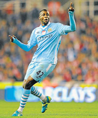 Manchester City's Yaya Toure celebrates after scoring against Stoke City in an EPL match on Saturday. AFP