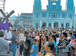 Devotees taking part in the 'Way of the cross' ceremony which represents the passion of Christ at Milagres Church in Mangalore on Friday.