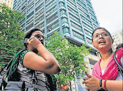 Employees came out of their high rise office building following an earthquake in Kolkata on Wednesday. PTI