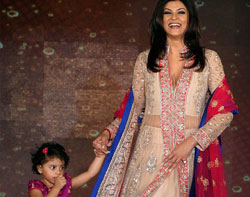 Mumbai: Bollywood actor Sushmita Sen walks the ramp with her daughter during the Save & Empower Girl Child campaign in Mumbai on Wednesday. PTI Photo