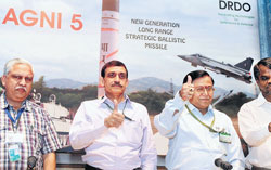Vijay Kumar Saraswat (2R), Director General, DRDO, secretary of defence and advisor to Indian Defence  Minister;  Avinash Chander (2L), chief controller (Missiles and Strategic Systems); V G Sekaran (R), the director of the Advanced System Laboratory (ASL) at DRDO; and R K Gupta (L) Agni V, ASL, gesture at a  press conference in New Delhi on Friday.  AFP