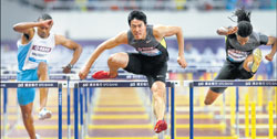 China's Liu Xiang (centre) powers towards the finishline in the Diamond League meeting in Shanghai on Saturday. AFP