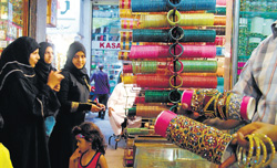 Women buying bangles at Laad Bazaar in Hyderabad. (Below) A few attractive bangles in a shop. Mohammed Aleemuddin