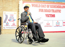 Harman Singh Sidhu on his wheel chair