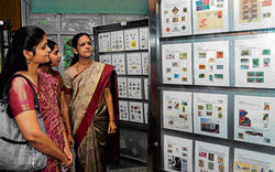 Visitors take a look at the stamp collection at the 'Olymphilex India 2012' organised at the  Philatelic Museum in Bangalore, on Friday. DH Photo