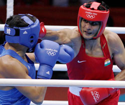Boxer Vijender Singh and Kazakstan's Dan Suzhanov during their 75kg bout of the 2012 London Olympic Games on Saturday. PTI