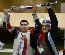 Indian shooter Gagan Narang poses with his coach Stanislav Lapidvs after winning bronze in 10m air rifle event at the Olympic Games 2012 in London on Monday. PTI