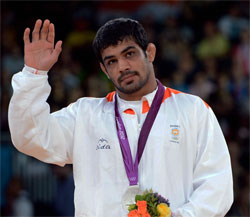 Silver medalist Sushil Kumar of India during the medals ceremony for men's 66-kg freestyle wrestling at the 2012 Summer Olympics in London on Sunday. PTI Photo