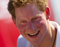 This is a Saturday March 10, 2012 file photo of Britain's Prince Harry, smiles after playing rugby at Flamengo's beach in Rio de Janeiro, Brazil. Photographs of a naked Prince Harry in a Las Vegas hotel room have popped up online. A celebrity gossip site published two pictures of the 27-year-old royal cavorting with what they called a mystery woman in a VIP suite. Prince Harry's office confirmed Wednesday Aug. 22. 2012 that the photos were of the prince but declined to make any further comment. (AP Photo/Felipe Dana, File)