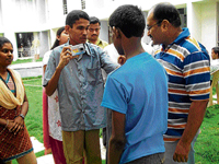 Visually impaired boys learn the art of photography from Partho Bhowmick