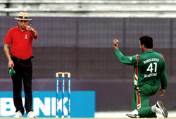 File photo of Bangladeshi cricketer Abdur Razzak (R) gesturing towards umpire Nadir Shah at The Sher-e-Bangla National Cricket Stadium in Dhaka. Cricket authorities have suspended six umpires at the centre of claims made by an television programme that they could be bribed to make favourable decisions during games. Three of those named were from Sri Lanka, while two were from Pakistan. The sixth was Nadir Shah, one of two Bangladeshi members of the ICC's international panel which officiates in matches around the world. AFP