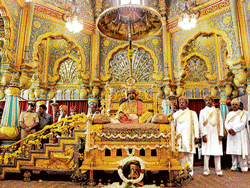 grandeur: Scion of the Mysore royal family Srikanta datta Narasimharaja Wadiyar sits on the throne as part of private  durbar during Dasara celebrations in Mysore on Tuesday. dh photo