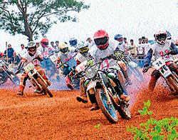 Dirt, drizzle, crash sets adrenalin pumping
