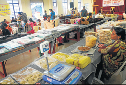 Women's Self Help Groups selling home-made products and accessories at Kanthi Church Hall near Mangaladevi temple on Saturday. DH Photo