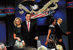 Continuing debate: US Republican Presidential candidate Mitt Romney and his wife Ann greet supporters as US President Barack Obama and his wife Michelle leave the stage at the end of the final presidential debate, at Lynn University in Boca Raton, Florida on Monday. AFP