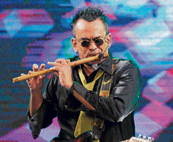 Energetic: Remo Fernandes presenting his popular number, 'The Flute Song'.
