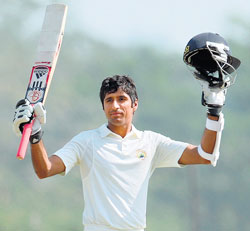 Haryana batsman Rahul Dewan acknowledges the cheers after completing his century against England. AFP