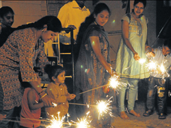 Mothers guide the young ones to celebrate Deepavali.  dh photo