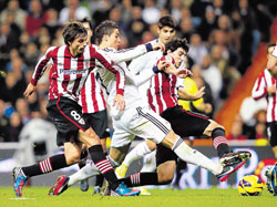 Real Madrid's Cristiano Ronaldo (2nd from left) vies for the ball with Athletic Bilbao's Ander Iturraspe (left) and Mikel San Jose in a La Liga match on Saturday. REUTERS