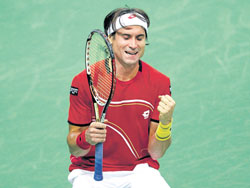 David Ferrer of Spain celebrates his win over Czech Republic's Tomas Berdych on Sunday. AFP