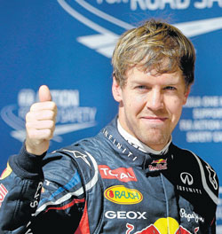 Sebastian Vettel celebrates after taking the pole at the US Grand Prix in Austin, Texas, on Saturday. AFP