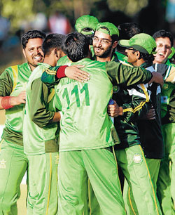 Pakistan players celebrate their win over India. DH Photo/ SATISH BADIGER