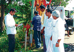 Bagepalli Taluk Panchayat Vice President Shankar Reddy inspects a borewell drilled in the taluk on Saturday. dh photo